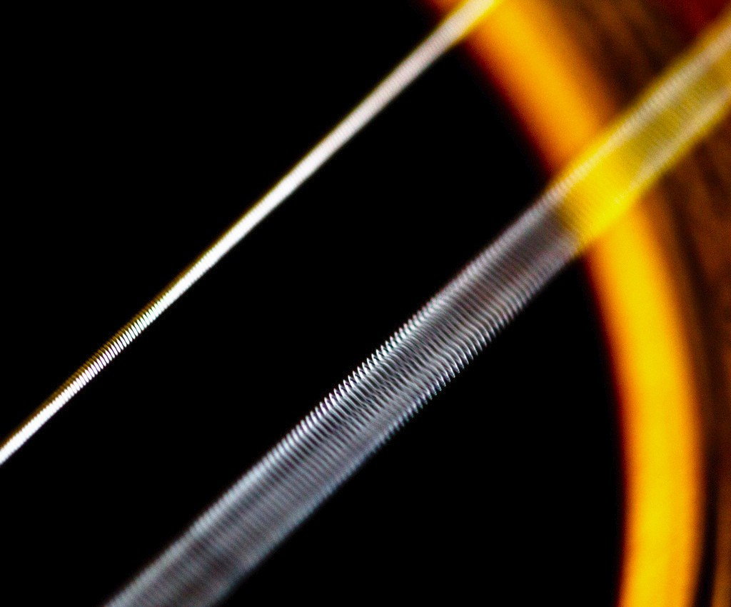 """Vibrating guitar string"" by jar [0] is licensed under CC BY 2.0"
